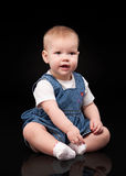 Little baby on a black background Royalty Free Stock Photo