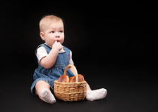 Little baby on a black background Stock Photography