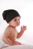 Little baby with black hat Royalty Free Stock Images