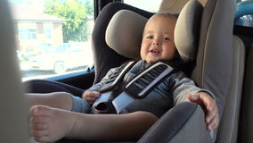 Little baby in booster chair in car stock video