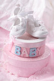 Little baby booties. And gift boxes royalty free stock image