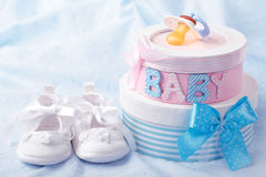 Little baby booties. And gift boxes stock photo
