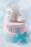 Little baby booties. And gift boxes stock photos