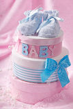 Little baby booties. And gift boxes royalty free stock photography
