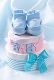 Little baby booties and gift boxes Stock Photography