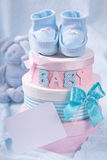 Little baby booties and gift boxes Royalty Free Stock Photos
