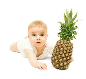 Little Baby Boy And Pineapple Royalty Free Stock Images