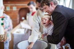 Little baby boy being baptized Royalty Free Stock Photography