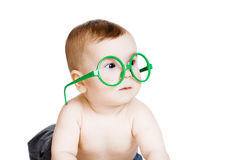 Little baby boy in the big funny glasses. isolated on white back Stock Image