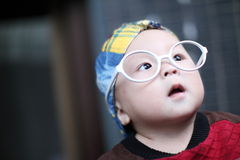 Little baby boy in the big  glasses Royalty Free Stock Images