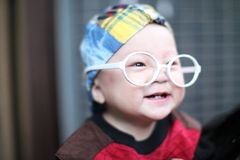 Little baby boy in the big  glasses Royalty Free Stock Photos