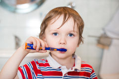 Little baby boy brushing his teeth in bathroom Royalty Free Stock Photos