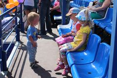 Little baby boy came to the children at the stadium in the summer on the street at the city sports festival summer 2014 in Novosib royalty free stock images