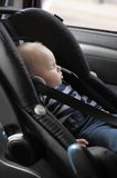 Little baby boy in car seat Stock Image