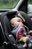 Little baby boy in car seat Stock Images