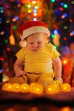 Little baby boy by a Christmas tree Stock Image