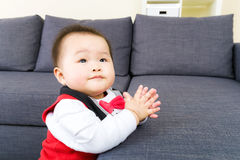 Little baby boy clapping Stock Images
