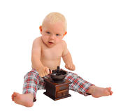 Little baby boy with coffee grinder wearing plaid pa nts Royalty Free Stock Photos