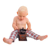 Little baby boy with coffee grinder wearing plaid pants Stock Images