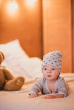 A little baby boy in a cosy room. A little baby boy in a fashion clothes in a cosy room stock photos