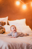 A little baby boy in a cosy room. A little baby boy in a fashion clothes in a cosy room royalty free stock photo