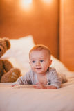 A little baby boy in a cosy room. A little baby boy in a fashion clothes in a cosy room stock photo