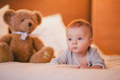 A little baby boy in a cosy room. A little baby boy in a fashion clothes in a cosy room royalty free stock image