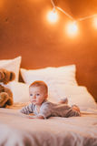 A little baby boy in a cosy room. A little baby boy in a fashion clothes in a cosy room royalty free stock images