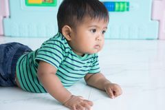 Cute little baby boy crawling on floor royalty free stock photos