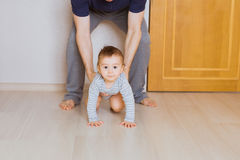 Little baby boy crawling on the floor at home Stock Images