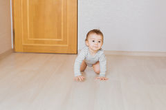 Little baby boy crawling on the floor at home Royalty Free Stock Photography