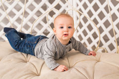 Little baby boy crawling on the floor at home Stock Image
