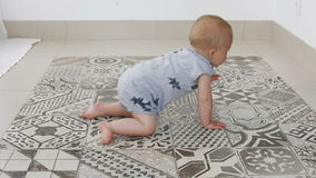 Little baby boy crawling on floor at home stock video footage