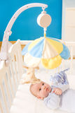 Little baby boy on crib Stock Image