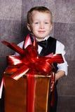 Little baby boy with Cristmas gift Stock Image
