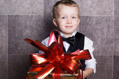 Little baby boy with Cristmas gift Stock Images