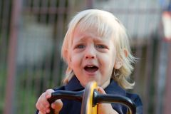 Crying little child on playground Stock Photography