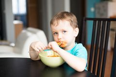 Little baby boy during dinner Stock Photography