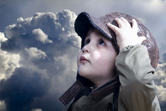 A little baby boy dreams of becoming a pilot Stock Photo