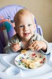 Little baby boy eating a banana cute Stock Image
