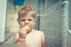 Little baby boy eating ice-cream on a beach house Royalty Free Stock Photo
