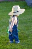 Little baby boy gardener Stock Images