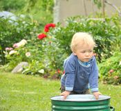 Little baby boy gardener playing Stock Images
