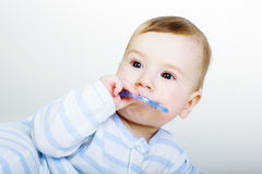 Little baby boy gnaws toy Stock Image