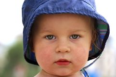 Little baby-boy in a hat in park in the summer Royalty Free Stock Image