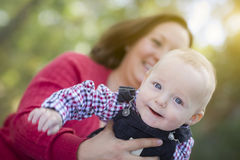 Little Baby Boy Having Fun With Mommy Outdoors Stock Images