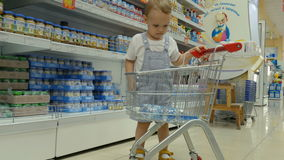 A little baby boy with his mother are shopping stock footage