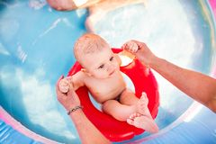 Little baby boy in the swimming pool. Stock Photo