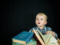 Little baby boy hold book. Studio photo Stock Photo