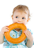 Little baby boy holding a bagel Stock Photo